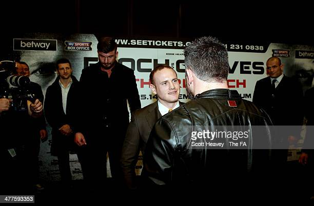 George Groves approaches Carl Froch's brother Lee Froch during a press conference to announce their up0coming Super Middleweight bout at Wembley...