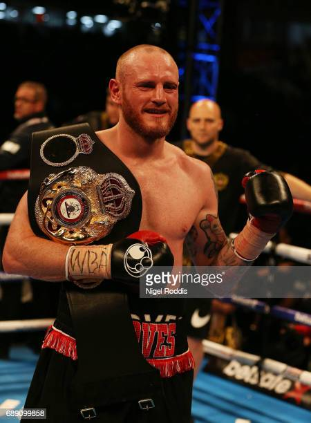 George Groves celebrates after beating Fedor Chudinov in their WBA SuperMiddleweight World Championship contest at Bramall Lane on May 27 2017 in...