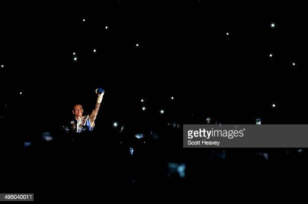 George Groves enters the ring for his IBF and WBA World Super Middleweight bout with Carl Froch at Wembley Stadium on May 31 2014 in London England