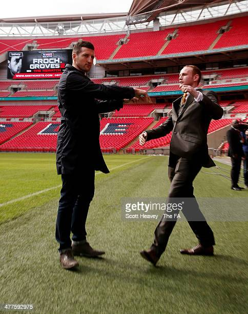 George Groves is shoved by Carl Froch during a press conference to announce their upcoming Super Middleweight bout at Wembley Stadium on March 10...