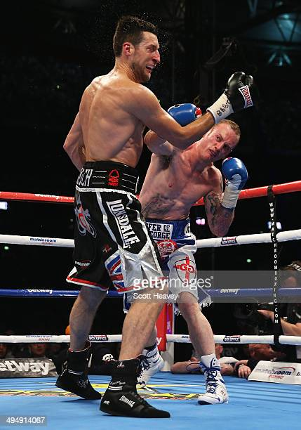George Groves of England in action against Carl Froch of England during their IBF and WBA World Super Middleweight title fight at Wembley Stadium on...