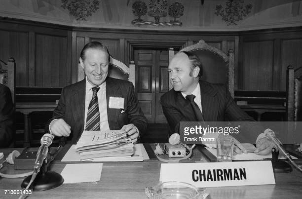 George Hall Assistant Under Secretary at the Foreign Office and meeting Chairman talks to Ted Rowlands British Minister of State at the Foreign...