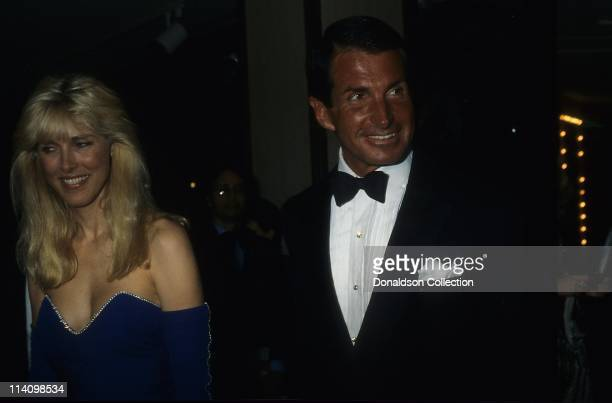 George Hamilton and Alana Stewart pose for a portrait in 1986 in Los Angeles California