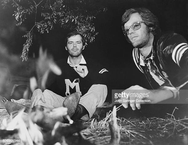 George Hanson smokes a joint beside Wyatt as the two sit at a campfire in a scene from the 1969 film Easy Rider