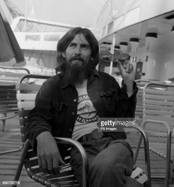 George Harrison aboard the liner QE2 from New York after 3 months recording in America