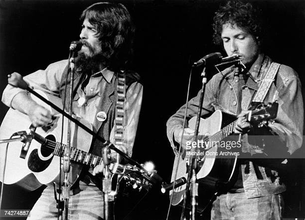 George Harrison and Bob Dylan perform onstage at the Concert for Bangladesh which was held at Madison Square Garden on August 1 1971 in New York City...