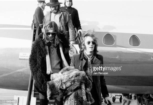 George Harrison and Eric Clapton arrive at Copenhagen Airport with American rock group Delaney And Bonnie December 1969