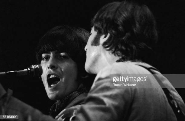 George Harrison and John Lennon in concert at the Nippon Budokan in Tokyo during the Beatles' Asian tour 1966