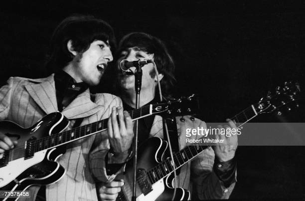 George Harrison and John Lennon on stage during the Beatles concert at Tokyos Budokan Hall Japan 1st July 1966