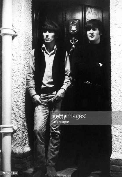 George Harrison and John Lennon pictured on a doorstep after the announcement that The Beatles have been awarded MBEs in the Queen's birthday honours...