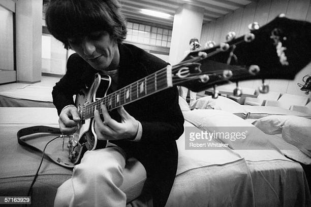 George Harrison backstage at the Nippon Budokan in Tokyo during the Beatles' Asian tour 1966