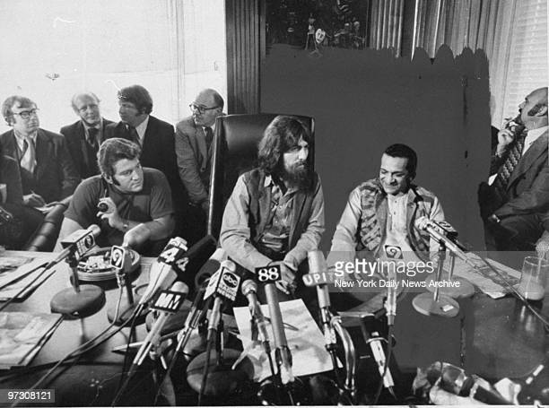 George Harrison flanked by Allen Klein and sitarist Ravi Shankar speaks to reporters about their benefit show for East Pakistan refugee children at...