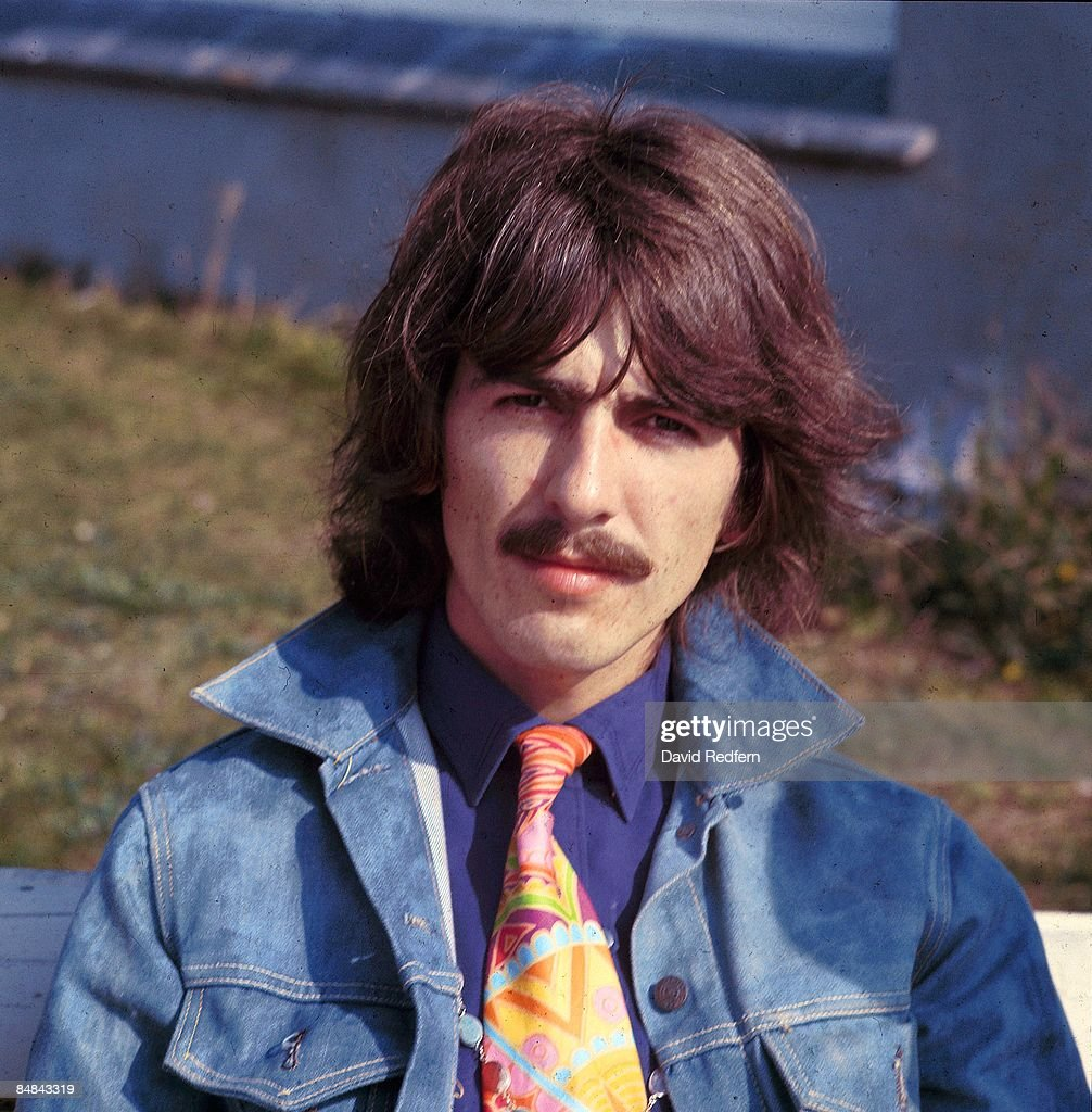 HOE Photo of George HARRISON, of The Beatles, posed during filming of Magical Mystery Tour - wearing denim jacket
