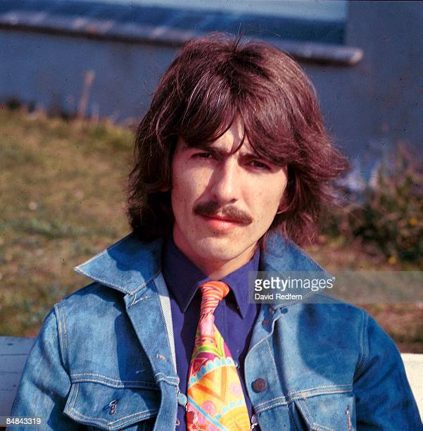 HOE Photo of George HARRISON of The Beatles posed during filming of Magical Mystery Tour wearing denim jacket
