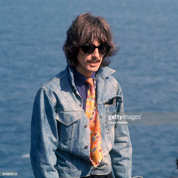 HOE Photo of BEATLES and George HARRISON and MAGICAL MYSTERY TOUR filming Magical Mystery Tour wearing sunglasses and denim jacket