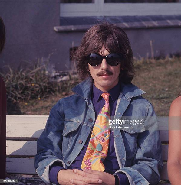 Guitarist George Harrison of The Beatles during the filming of the Magical Mystery Tour in Plymouth Hoe England on September 12 1967
