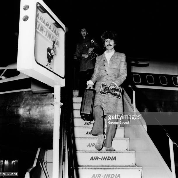George Harrison of the Beatles arrives at London Airport on an Air India flight 16th January 1968 He had been in Bombay producing the soundtrack to...