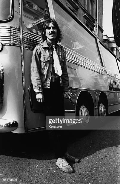 George Harrison of the Beatles leaves the bus in Plymouth during the location filming of 'Magical Mystery Tour' 1967