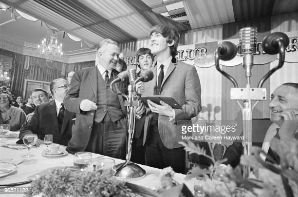 George Harrison of the Beatles with British Labour Leader of the Opposition Harold Wilson at the Variety Club of Great Britain Annual Show Business...
