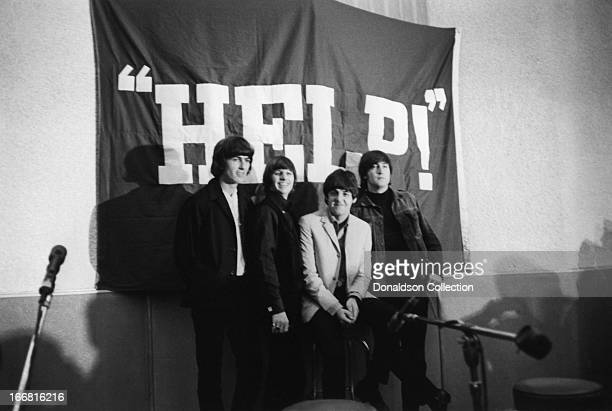 George Harrison Ringo Starr Paul McCartney and John Lennon of the rock and roll group 'The Beatles' at a press conference for the release of their...