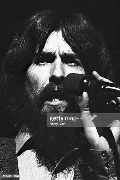 George Harrison sings on stage during the 1971 Concert for Bangladesh