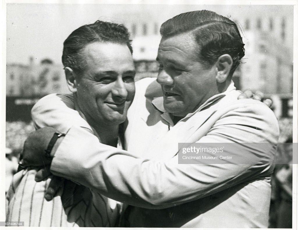 George Herman (Babe) Ruth (1895 - 1948) hugs former teammate Lou Gehrig (1903 - 1941), 1939.