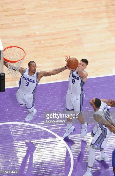 George Hill and Bogdan Bogdanovic of the Sacramento Kings rebound against the Philadelphia 76ers on November 9 2017 at Golden 1 Center in Sacramento...