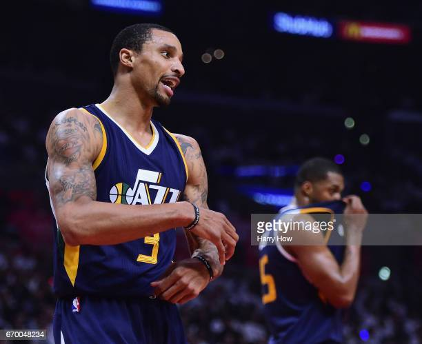 George Hill and Derrick Favors of the Utah Jazz calls for a foul during a 9991 LA Clippers win in Game Two of the Western Conference Quarterfinals...