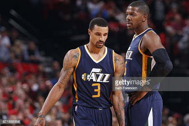 George Hill and Joe Johnson of the Utah Jazz look on during the game against the Portland Trail Blazers on October 25 2016 at the Moda Center Arena...