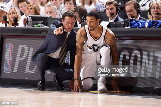 George Hill and Quin Snyder of the Utah Jazz looks on during the game against the Los Angeles Clippers during Game Six of the Western Conference...