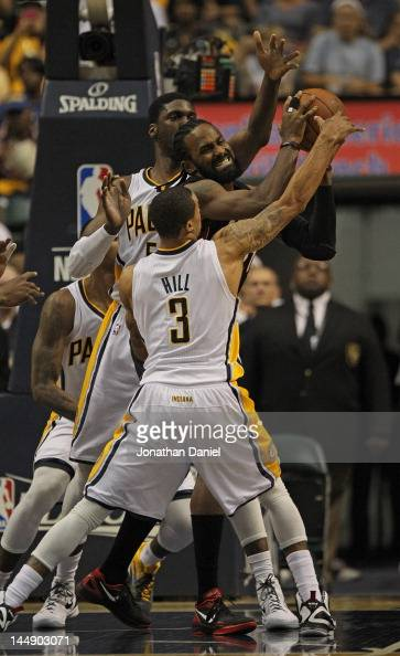 George Hill and Roy Hibbert of the Indiana Pacers pressure Ronny Turiaf of the Miami Heat in Game Four of the Eastern Conference Semifinals in the...