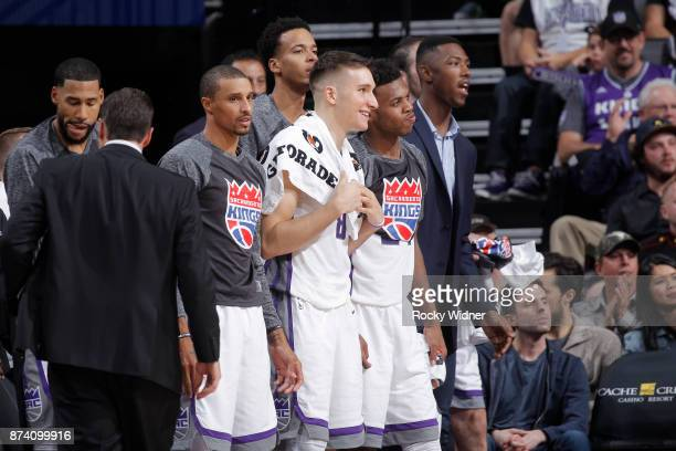 George Hill Bogdan Bogdanovic and Buddy Hield of the Sacramento Kings look on during the game against the Philadelphia 76ers on November 9 2017 at...
