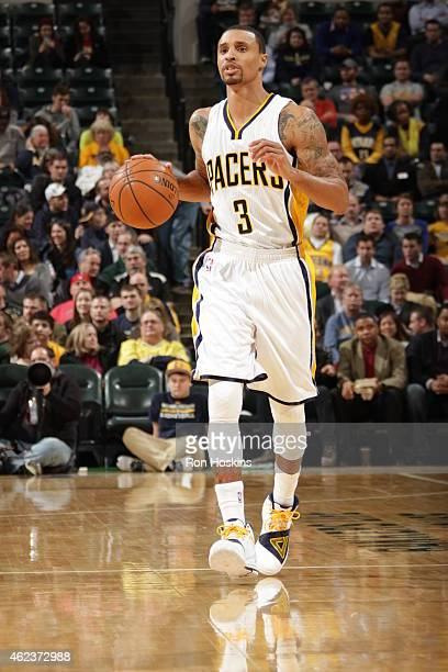 George Hill of the Indiana Pacers brings the ball up court against the Toronto Raptors on January 27 2015 at Bankers Life Fieldhouse in Indianapolis...