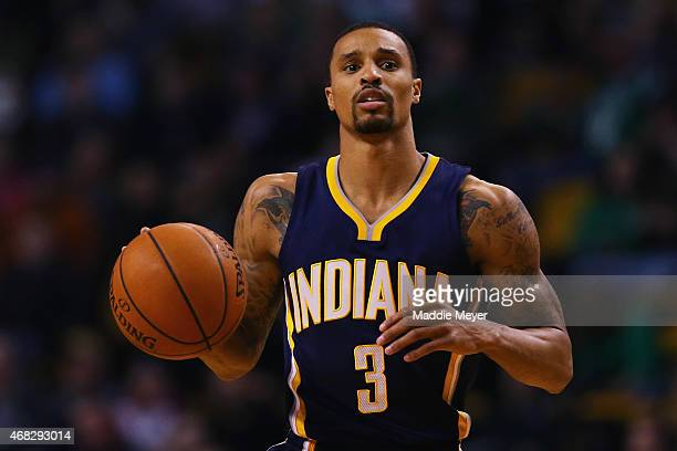 George Hill of the Indiana Pacers carries the ball against the Boston Celtics during the first quarter at TD Garden on April 1 2015 in Boston...