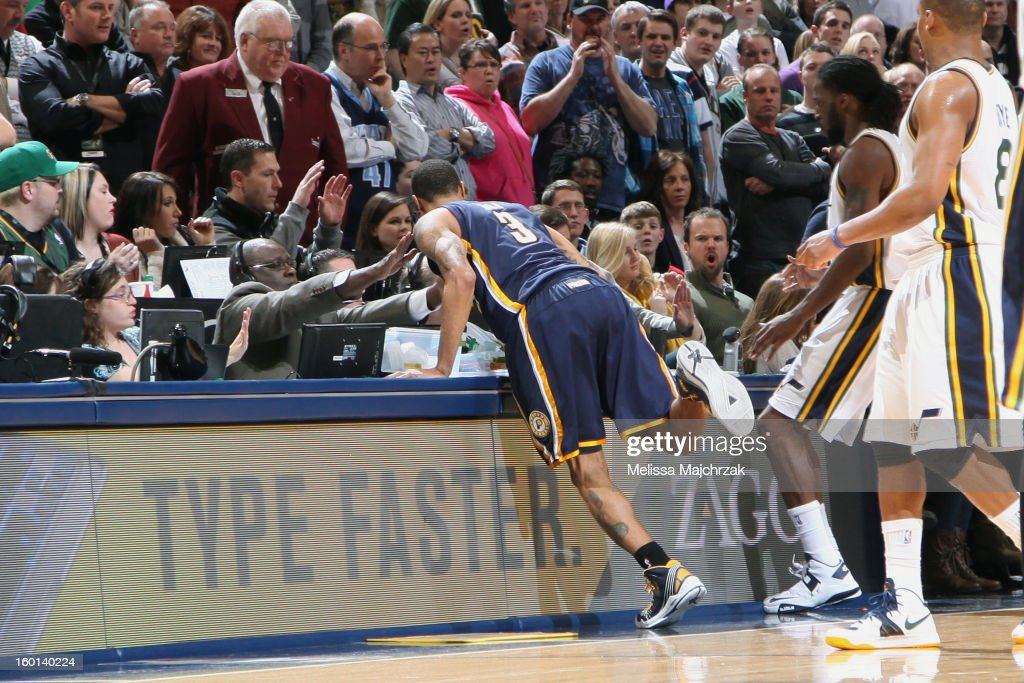 George Hill #3 of the Indiana Pacers chases a ball into the crowd during play against the Utah Jazz at Energy Solutions Arena on January 26, 2013 in Salt Lake City, Utah.
