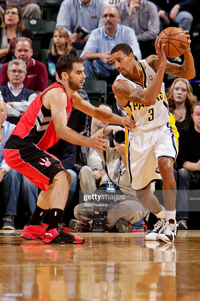 George Hill #3 of the Indiana Pacers controls the ball against Jose Calderon #8 of the Toronto Raptors on November 13, 2012 at Bankers Life Fieldhouse in Indianapolis, Indiana.