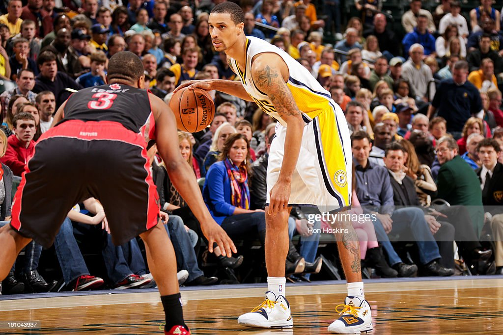 George Hill #3 of the Indiana Pacers controls the ball against <a gi-track='captionPersonalityLinkClicked' href=/galleries/search?phrase=Kyle+Lowry&family=editorial&specificpeople=714625 ng-click='$event.stopPropagation()'>Kyle Lowry</a> #3 of the Toronto Raptors on February 8, 2013 at Bankers Life Fieldhouse in Indianapolis, Indiana.