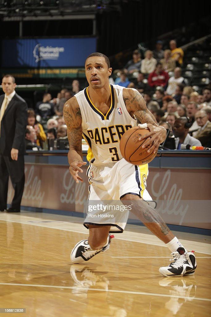 George Hill #3 of the Indiana Pacers crosses over vs the New Orleans Hornets on November 21, 2012 at Bankers Life Fieldhouse in Indianapolis, Indiana.