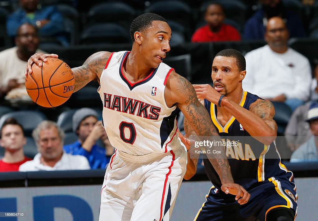George Hill #3 of the Indiana Pacers defends against <a gi-track='captionPersonalityLinkClicked' href=/galleries/search?phrase=Jeff+Teague&family=editorial&specificpeople=4680498 ng-click='$event.stopPropagation()'>Jeff Teague</a> #0 of the Atlanta Hawks at Philips Arena on October 22, 2013 in Atlanta, Georgia.