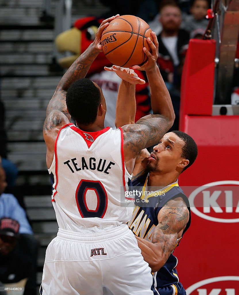 George Hill #3 of the Indiana Pacers defends against Jeff Teague #0 of the Atlanta Hawks at Philips Arena on January 8, 2014 in Atlanta, Georgia.