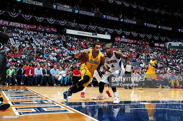 George Hill of the Indiana Pacers dribbles baseline against the Atlanta Hawks during Game Four of the Eastern Conference Quarterfinals on April 26...