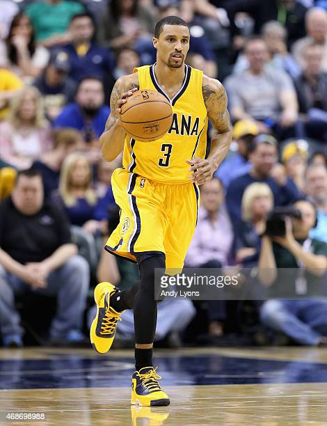 George Hill of the Indiana Pacers dribbles the ball against the Miami Heat at Bankers Life Fieldhouse on April 5 2015 in Indianapolis Indiana Tonight...