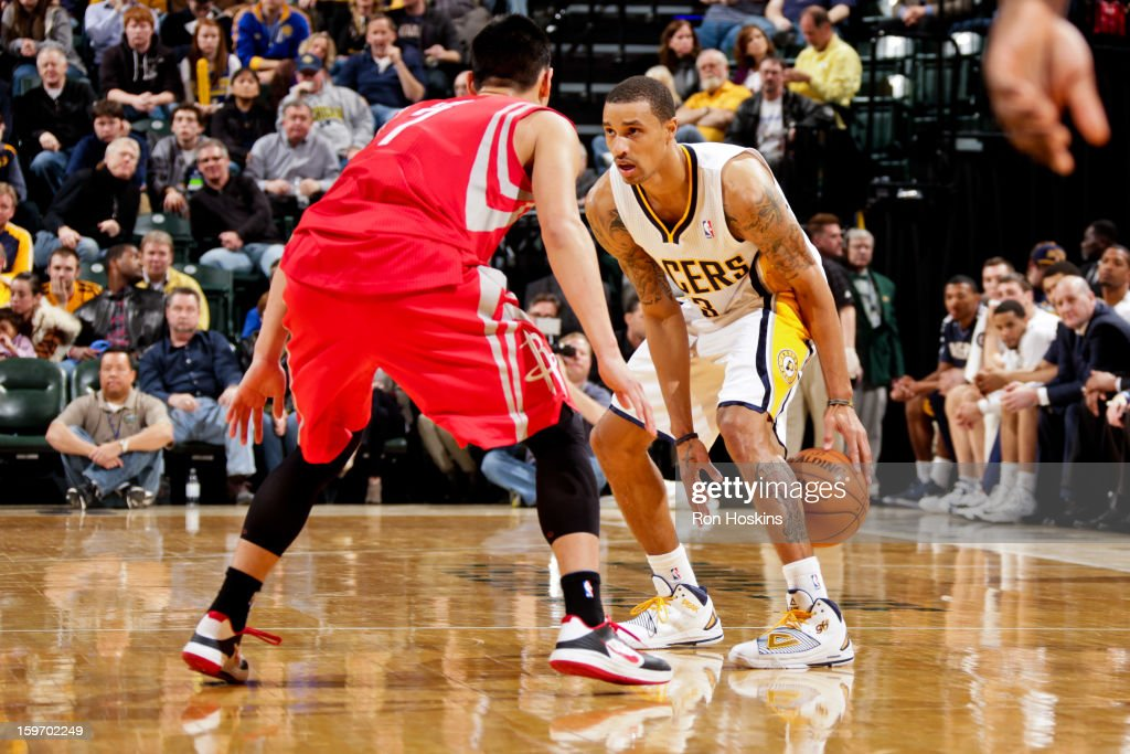George Hill #3 of the Indiana Pacers dribbles the ball between his legs against <a gi-track='captionPersonalityLinkClicked' href=/galleries/search?phrase=Jeremy+Lin&family=editorial&specificpeople=6669516 ng-click='$event.stopPropagation()'>Jeremy Lin</a> #7 of the Houston Rockets on January 18, 2013 at Bankers Life Fieldhouse in Indianapolis, Indiana.