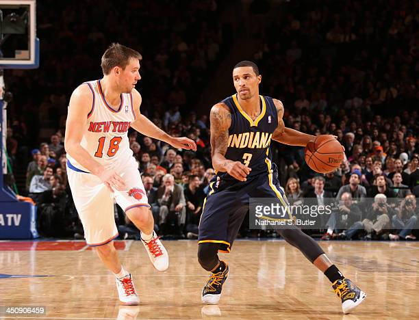 George Hill of the Indiana Pacers drives against Beno Udrih of the New York Knicks guards him during a game at Madison Square Garden in New York City...