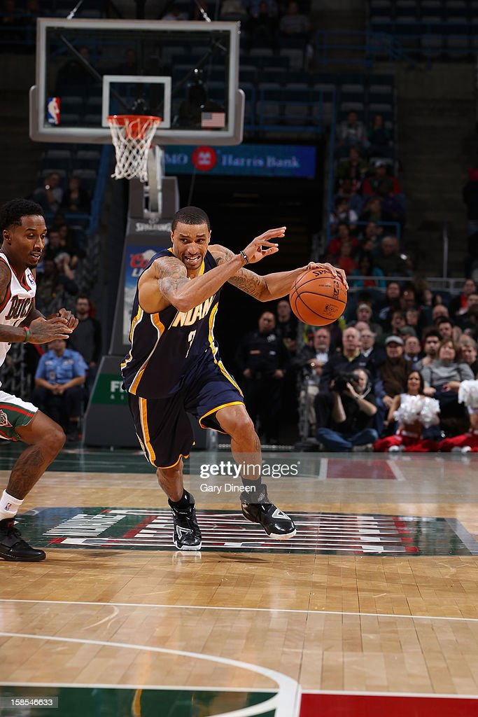 George Hill #3 of the Indiana Pacers drives against Brandon Jennings #3 of the Milwaukee Bucks during the game on December 18, 2012 at the BMO Harris Bradley Center in Milwaukee, Wisconsin.