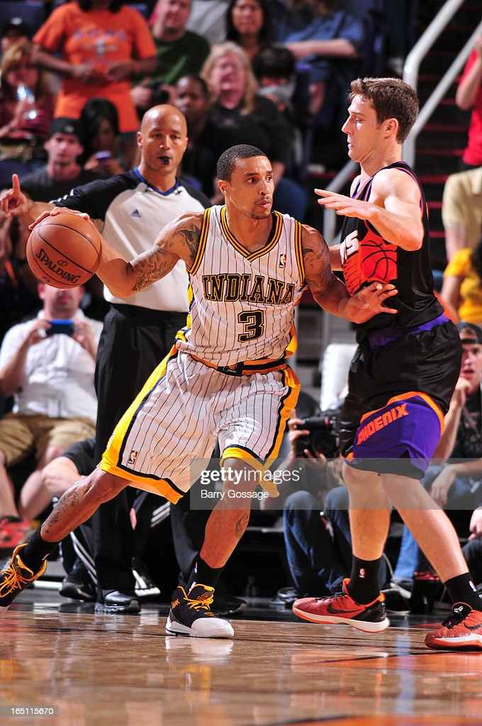 George Hill #3 of the Indiana Pacers drives against Goran Dragic #1 of the Phoenix Suns on March 30, 2013 at U.S. Airways Center in Phoenix, Arizona.