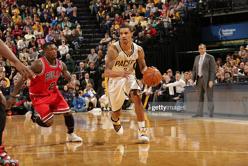 George Hill #3 of the Indiana Pacers drives against <a gi-track='captionPersonalityLinkClicked' href=/galleries/search?phrase=Nate+Robinson&family=editorial&specificpeople=208906 ng-click='$event.stopPropagation()'>Nate Robinson</a> #2 of the Chicago Bulls during the game between the Indiana Pacers and the Chicago Bulls on February 4, 2013 at Bankers Life Fieldhouse in Indianapolis, Indiana.