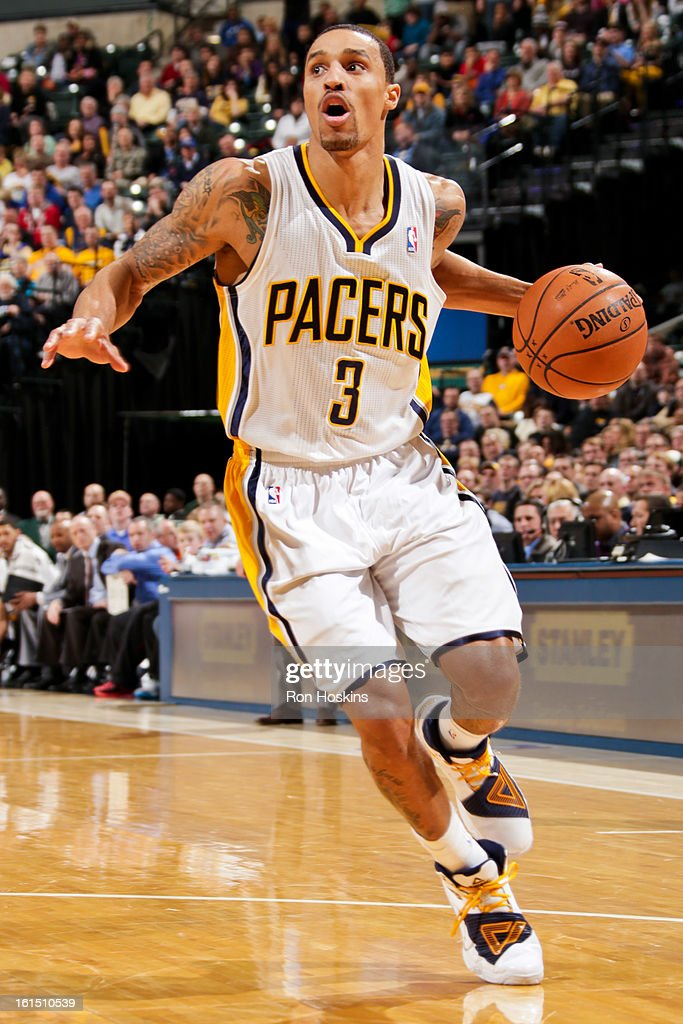 George Hill #3 of the Indiana Pacers drives against the Brooklyn Nets on February 11, 2013 at Bankers Life Fieldhouse in Indianapolis, Indiana.