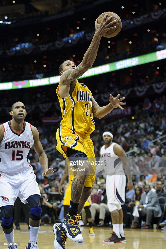 George Hill #3 of the Indiana Pacers drives to the basket against Al Horford #15 of the Atlanta Hawks during the second half at Philips Arena on May 3, 2013 in Atlanta, Georgia. The Pacers defeated the Hawks 81-73.