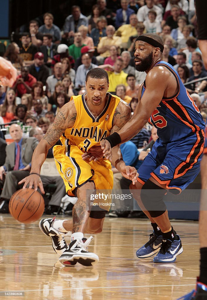 George Hill #3 of the Indiana Pacers drives to the basket against <a gi-track='captionPersonalityLinkClicked' href=/galleries/search?phrase=Baron+Davis&family=editorial&specificpeople=201592 ng-click='$event.stopPropagation()'>Baron Davis</a> #85 of the New York Knicks during the game on April 3, 2012 at Bankers Life Fieldhouse in Indianapolis, Indiana.